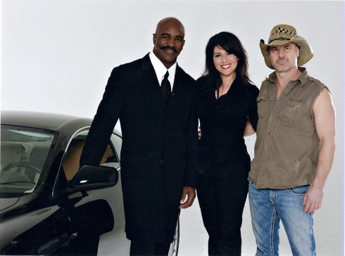 Tammy Lier Gibson with Evander Holyfield and Peter Lik
